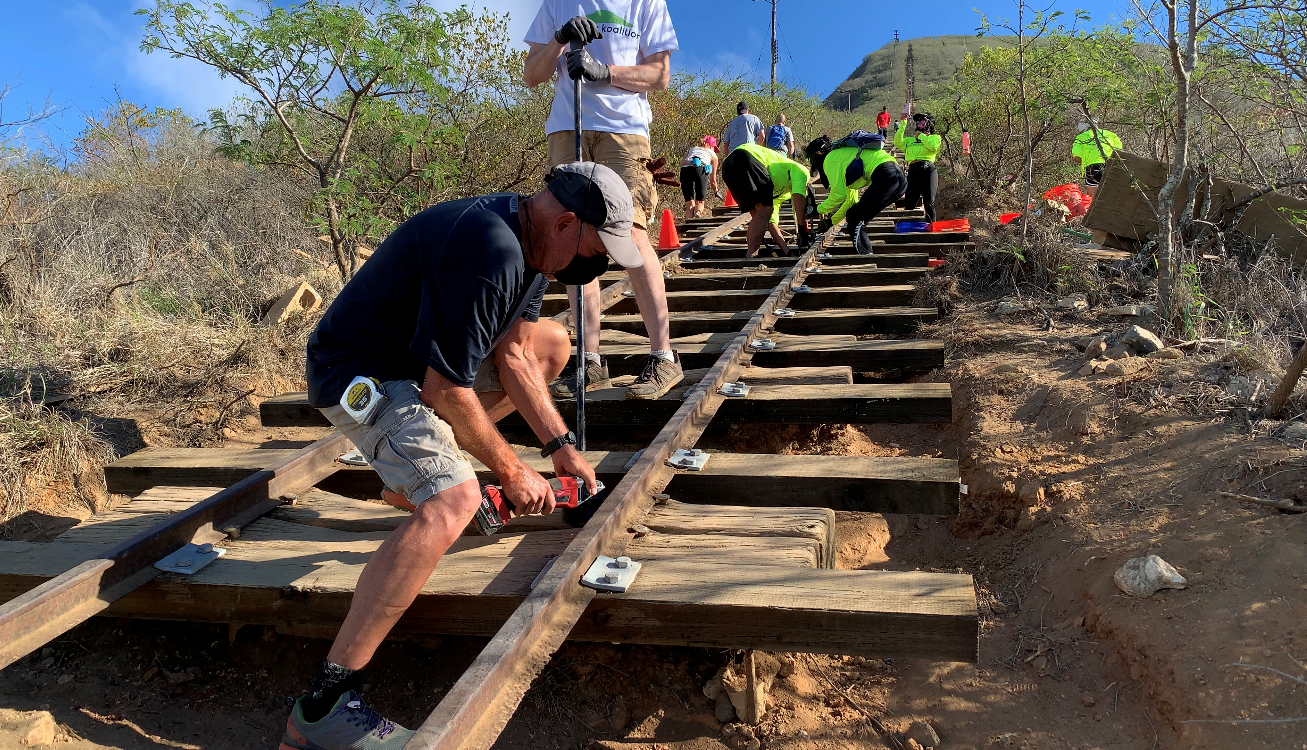Volunteers with the Kokonut Koalition work on immediate repairs to the Koko Head Tramway